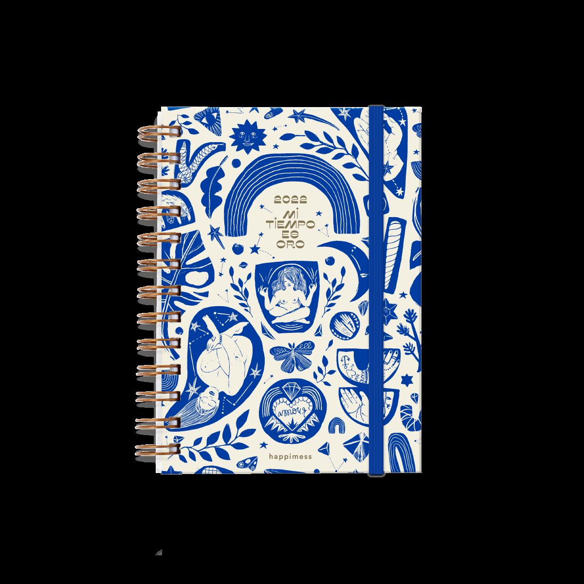 Agenda anillada Modelo Happimess Mi tiempo es oro, cerrada, tapa dura, de frente, con elástico azul e ilustración de tapa en tonos azules sobre fondo blanco.