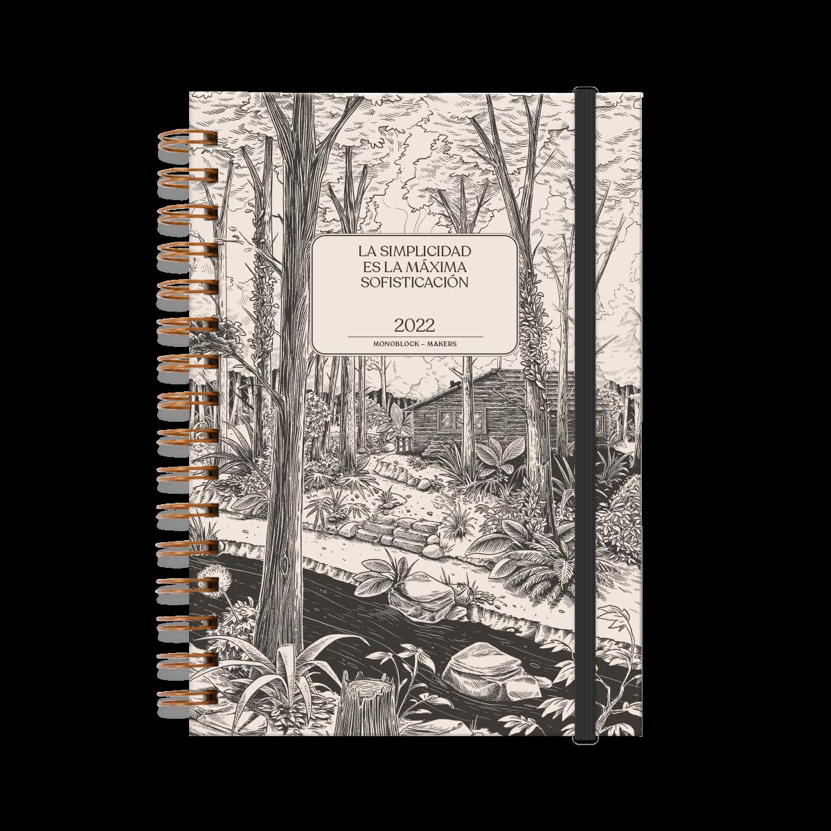 Agenda 2022 anillada modelo makers Simplicidad, de frente, cerrada con elástico, ilustración en blanco y negro de una cabaña, un bosque y un río.
