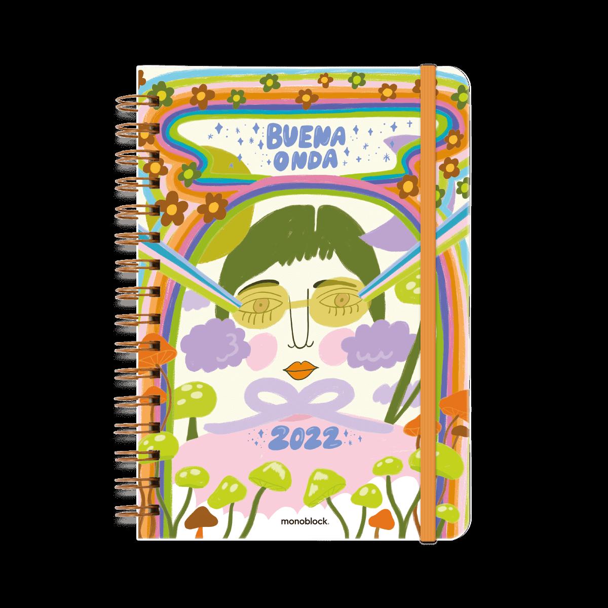 Tapa de agenda con la leyenda Buena Onda, con una ilustración central de una mujer con gafas reondeadas, arcoiris en tonos verdes, rosa, azul y celeste, con pequeñas flores y hongos sombrero.