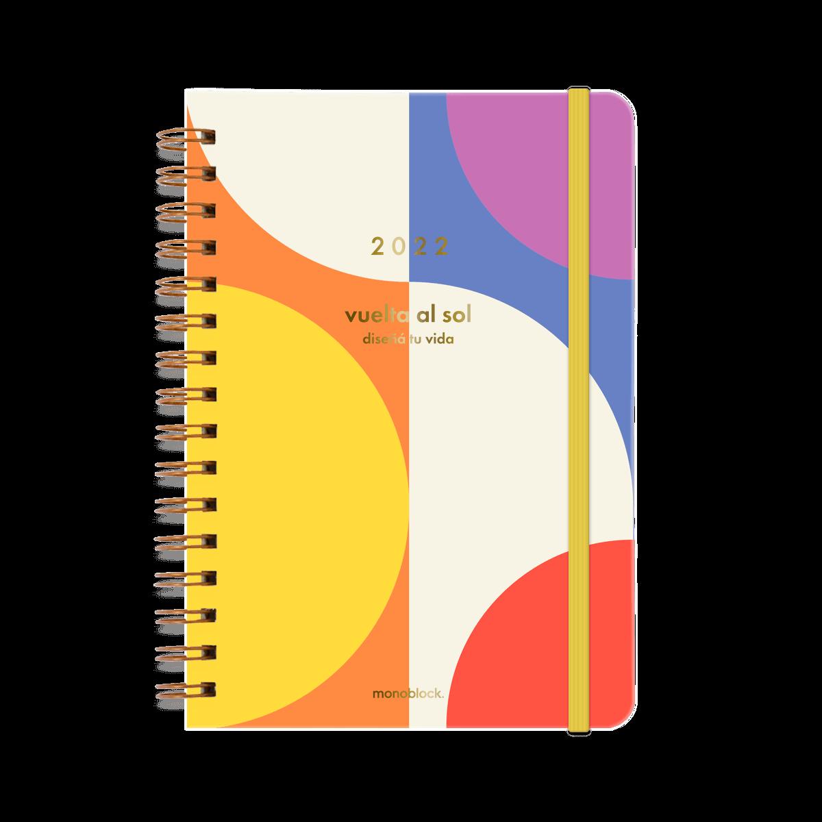 Agenda Vuelta al sol 2022 anillada en tapa dura con elástico amarillo, de colores vibrantes como el arcoiris y puntas redondeadas, con detalles en metalizado dorado.
